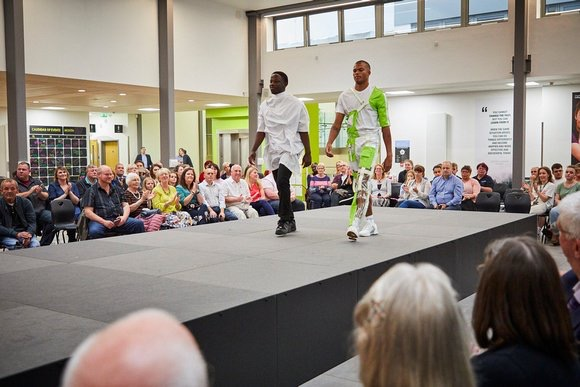 Two men walking on a NexGen Catwalk